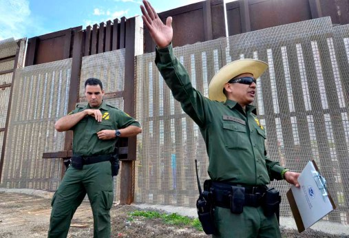 Border Community Liaison Agent Officer Frank Alvarado (right) tells the crowd about procedures for the border visits. Photo by Chris Stone