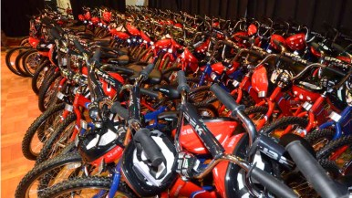 The San Diego Chargers with Bikes for Kids gave away 150 bikes at Baker Elementary School. Photo by Chris Stone