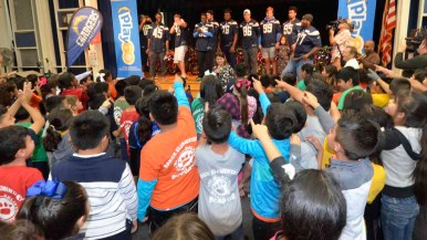Children at Baker Elementary School thank the Chargers for the new bikes. Photo by Chris Stone