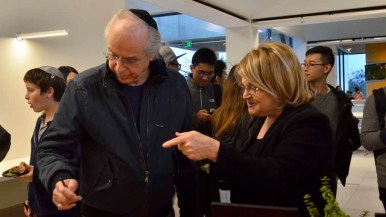 Jerry and Miriam Goldstein sample free dishes at the UCSD restaurant grand opening. Photo by Chris Stone