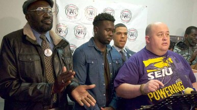 Richard Olango Abuka (left) and his son, Tony, stand beside David Garcias of SEIU Local 221. Photo by Ken Stone
