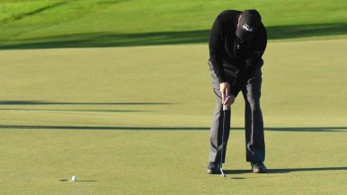 Phil Mickelson putts at the 18th hole in the Zurich Pro-Am in the Farmers Open. Photo by Chris Stone