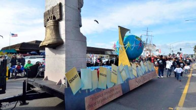 San Diego City College's float showed a liberty bell, globe and Martin Luther King Memorial replica statue. Photo by Chris Stone