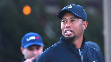 Teeing off about 6:40 a.m., Tiger Woods gets back into swing of PGA golf after back surgery. Photo by Chris Stone