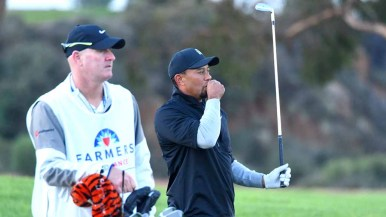 Tiger Woods blows into his hand as Torrey Pines Golf Course temps hovered in the 40s. Photo by Chris Stone