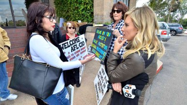 Sandy Naranjo chats with CBS8 reporter Ashley Jacobs near end of demonstration. Photo by Ken Stone