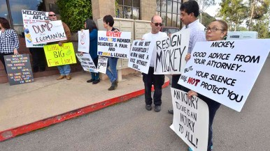Signs urged Mickey Kasparian to resign his labor posts and gave advice. Photo by Ken Stone