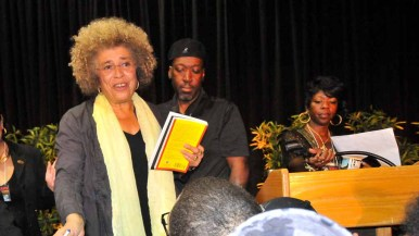 Angela Davis speaks to well-wishers as she autographs books after her speech. Photo by Chris Stone
