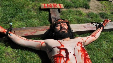 Raymundo Rivera portrays Jesus in a re-enactment of the the crucifixion on Good Friday. Photo by Chris Stone