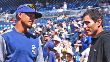 Padres general manager A.J. Preller (right) speaks with Luis Sardinas, who has been a catcher but caught fans' eyes with his recent pitching. Photo by Chris Stone
