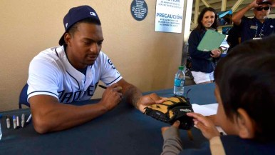 Christian Bethancourt signs an autograph for a young fan. Photo by Chris Stone