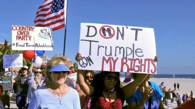 Anti-GOP protesters walk along Ocean Boulevard and then along the beach by the Hotel del Coronado. Photo by Chris Stone