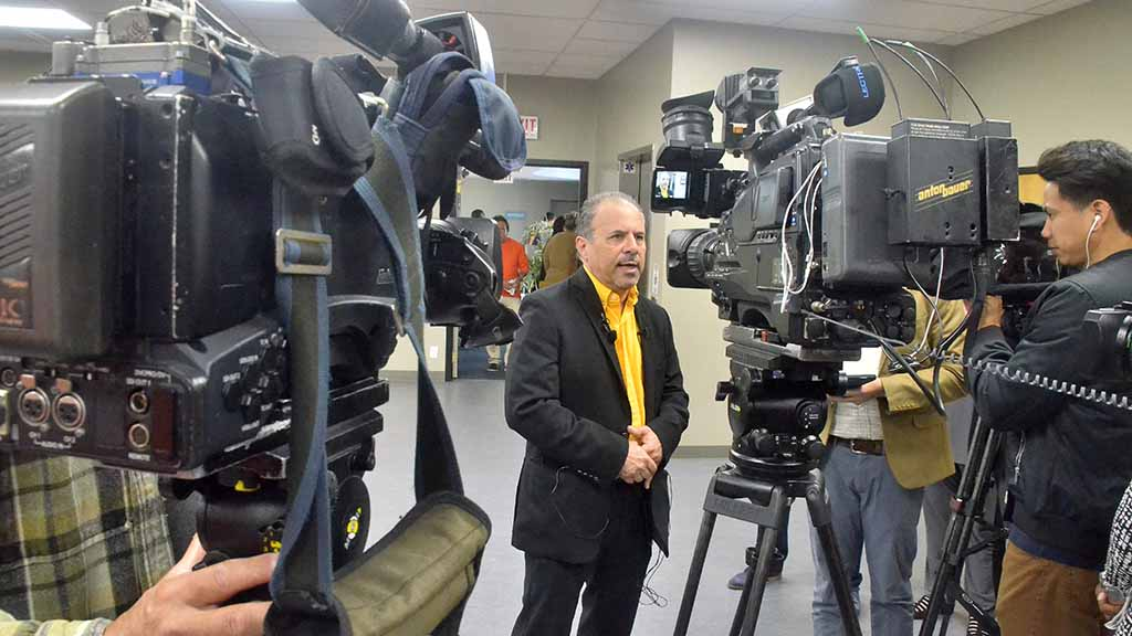 Mickey Kasparian, a labor leader for decades, stands for camera crews after 20-minute news conference in Mission Valley.