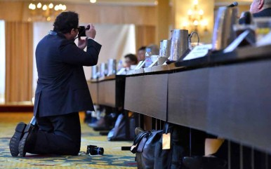RNC photographer Doug Coulter of Atlanta gets low for a shot of Rules Committee. Photo by Ken Stone