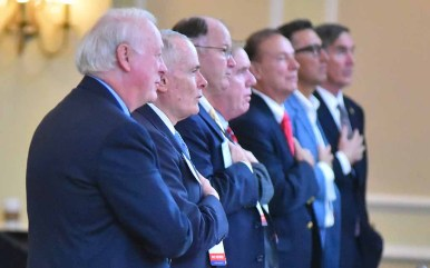 Members of the RNC Rules Committee recite the Pledge of Allegiance. Photo by Ken Stone