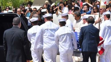 Navy pallbearers carry the casket of Carlos Sibayan at Corpus Christi Catholic Church. Photo by Chris Stone