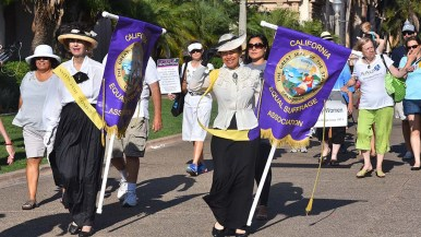 About 80 people, mostly women, marched in Balboa Park in the annual suffragette march.