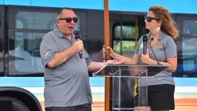 Randy Schimka and April Bolduc of San Diego Gas & Electric make electric car presentation.