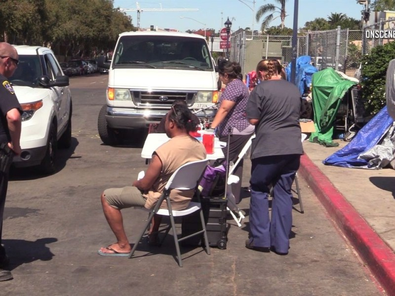 Police assist homeless individuals