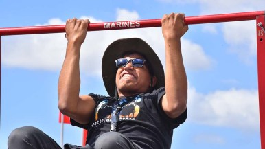 Ruben Serrano of Downey tries his hands at a Marine pull-up challenge