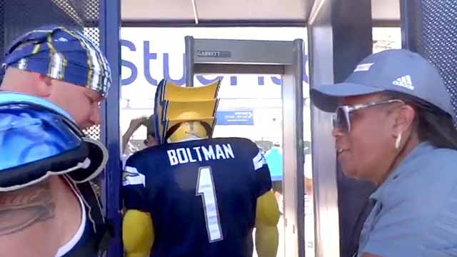 Image from video shows Dan Jauregui as Boltman passing through security without removing his headmask.