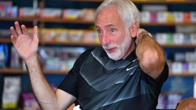 """USATF President Vin Lananna, holding court at Milestone Running shop, says his next """"listening tour"""" stop will be November in North Carolina."""