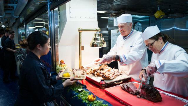 Richard Spencer serves Thanksgiving dinner