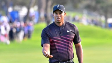 Tiger Woods gestures after missing a putt on the 18th green at Torrey Pines South Course.