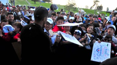 Youngsters screamed for a souvenir signing after Tiger Woods finished at 72, even par. Photo by Chris Stone