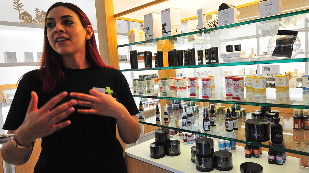 Jackie Callison, floor manager at Apothekare, explains the cannabis-infused products.