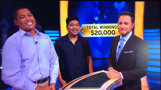 David Tamayo and a cousin are shown with host Chris Harrison and Cymer staffer's winnings: $20,000.