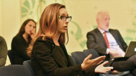 Union-Tribune reporter Lyndsay Winkley asks panel a question as U-T opinion director live-tweets in the background.