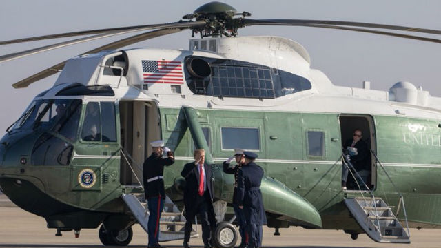 Donald Trump leaves helicopter