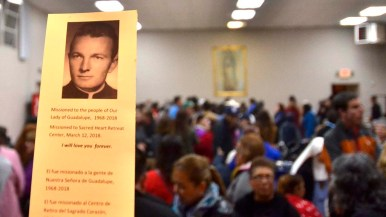 Attendees received a prayer card for Fr. Brown following his 50 years of service to the parish.