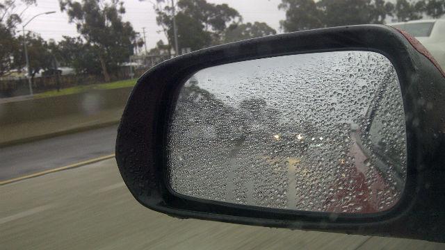 Rain on car's side mirror