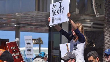 A young woman expresses her fear on her poster at the anti-gun violence march.