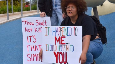 A young woman who experienced a school shooting protested at the anti-gun violence march.