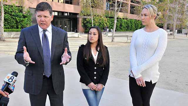 Dan Gilleon answers questions on the police-raid case in March 2017 alongside former Cheetahs dancer Renee L. (left) and Mallory M.