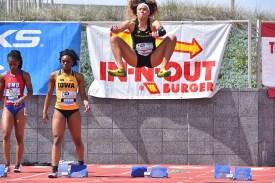 Lauren Rain Williams of Oregon gets her muscles firing ahead of start of 100-meter dash.