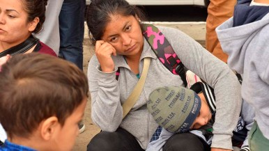 Many women and children from Mexico and Central America waited to see if they would be the next people allowed to enter the U.S.