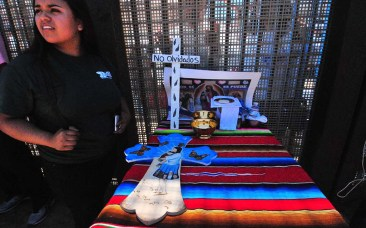 A Border Angel member painted a cross to be sent from San Diego to the tip of South America.