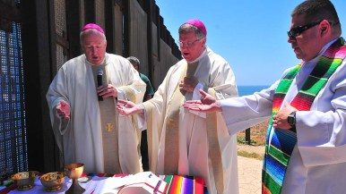 Bishop Robert McElroy (left) and Associate San Diego Bishop John Dolan celebrate Mass on the American side of the border.