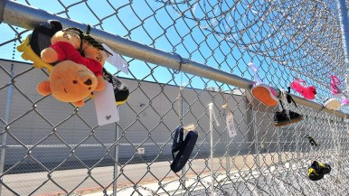 "Faith leaders and ""moral witnesses"" tied children's shoes, keys and toys to the detention center fence."