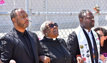 Faith leaders sing, chant and pray at the detention facility.