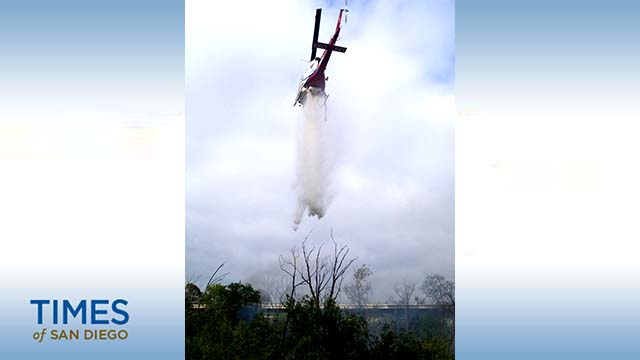 National City Fire Department photo of helicopter making water drop near Westfield Plaza Bonita.