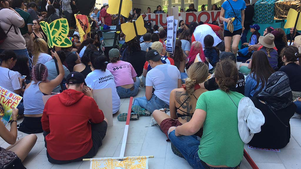 Dozens taking part in sit-down protest at San Diego federal building.
