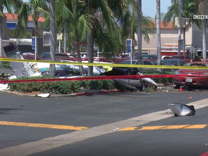 Wreckage of plane in parking lot