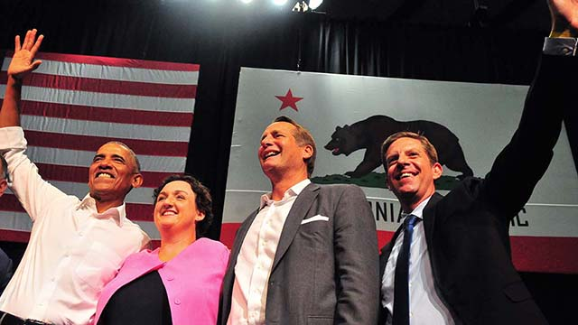 Barack Obama poses with Congressional candidates (left to right) Katie Porter, Harley Rouda and Mike Levin.