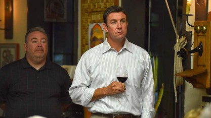 Rep. Duncan Hunter, drink in hand, watches speakers alongside his chief of staff Mike Harrison