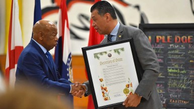 Secretary of State Alex Padilla presents a commendation to Rep. John Lewis.